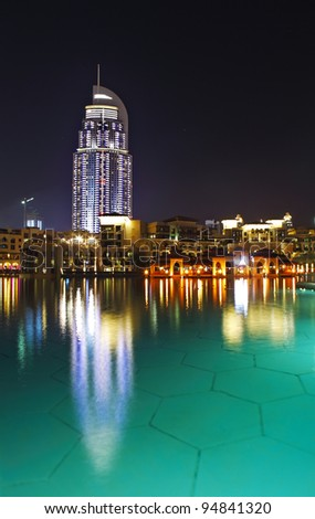 DUBAI, UAE - JANUARY 1: The Address Hotel in the downtown Dubai area overlooks the famous dancing fountains, taken on January 01, 2012 in Dubai. The hotel is surrounded by a mall, hotels and Burj Khalifa - stock photo
