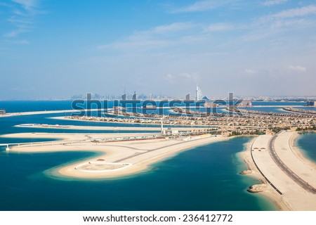 DUBAI, UAE - JANUARY 20: The Palm on January 20, 2011 in Dubai, UAE. The Palm is an artificial island with many luxury hotels and villas. Helicopter view - stock photo