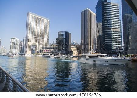 DUBAI, UAE - JANUARY 17, 2014: View at modern skyscrapers in Dubai Marina in Dubai, UAE. When the entire development is complete, it will accommodate more than 120,000 people. - stock photo
