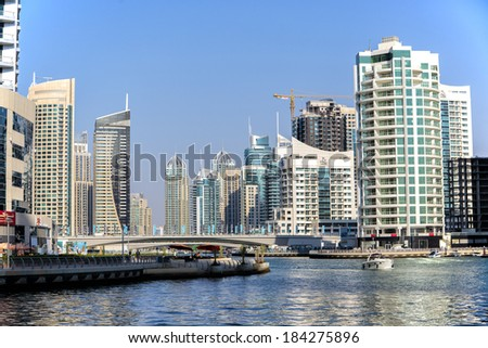 DUBAI, UAE - JANUARY 17, 2014: View at modern skyscrapers in Dubai Marina in Dubai, UAE. When the entire development is complete, it will accommodate more than 120,000 people.