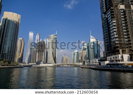 DUBAI, UAE - JANUARY 16, 2014: View at modern skyscrapers in Dubai Marina in Dubai, UAE. When the entire development is complete, it will accommodate more than 120,000 people.