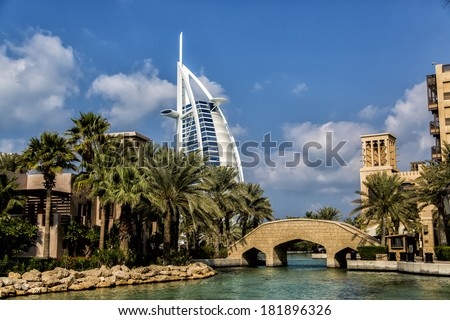 DUBAI, UAE - JANUARY 16, 2014: View of hotel Burj al Arab from Madinat Jumeirah in Dubai. At 321 m, it is the fourth tallest hotel in the world and has 202 rooms. - stock photo