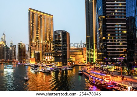 DUBAI, UAE - JANUARY 16, 2015 : View of modern skyscrapers in Jumeirah beach residence on January 16, 2015 in Dubai, JBR - artificial canal city, carved along a 3 km stretch of Persian Gulf shoreline. - stock photo