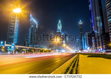 DUBAI, UAE - JANUARY 10: View of Sheikh Zayed Road skyscrapers in Dubai, UAE on JANUARY 10, 2013. More than 25 skyscrapers can be found here.