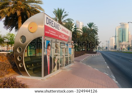 DUBAI, UAE - 16 JULY 2014: Enclosed, air conditioned, city bus stop in downtown Dubai. - stock photo