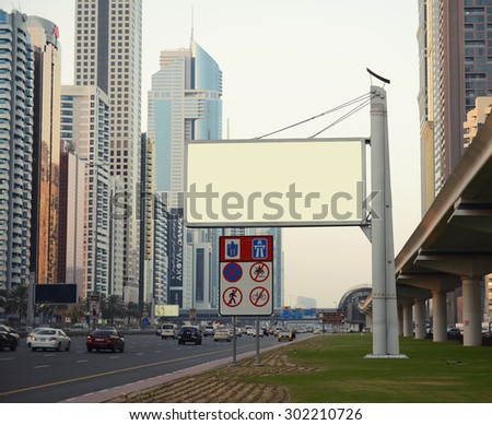 DUBAI, UAE - July 15: View of Sheikh Zayed Road skyscrapers in Dubai, UAE on  JULY 15, 2015.  you can put your advertising on the panel - stock photo