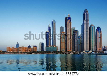 DUBAI, UAE - JUN 18: A view of Dubai Marina at Dusk on Jun 18, 2013 in Dubai, UAE. The Marina in Dubai has more tall towers over 50 stories than Manhattan New York City - stock photo