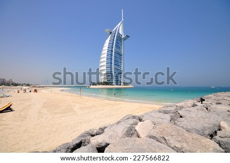 DUBAI, UAE - JUNE 27, 2014: Burj Al Arab in Dubai, as seen on June 27, 2014. It is a 7-star hotel built on an artificial island and is the fourth tallest hotel in the world. - stock photo