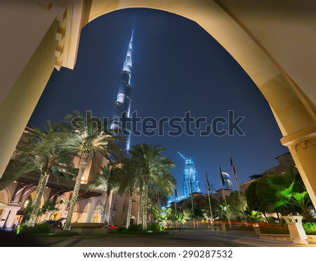 Dubai / UAE - June 5: Burj Khalifa the tallest building in the world behind the entrance of the The Palace Hotel and Souk Al Bahar on June 5 ,2015 in Dubai. - stock photo