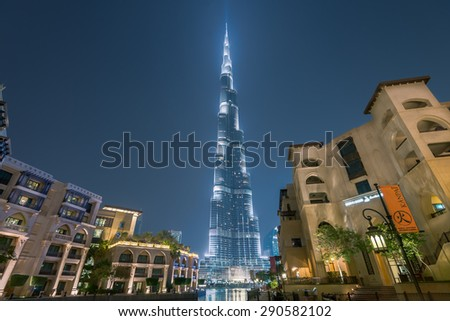 Dubai /UAE - June 5: Burj Khalifa the tallest building in the world situated in the famous landmark near by Dubai mall, Dubai fountain show, hotels and Souk Al Bahar on June 5,2015 in Dubai. - stock photo