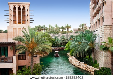 DUBAI, UAE - JUNE 3: The famous hotel and tourist district of Madinat Jumeirah 3, 2013 in Dubai. Built with ancient style, has many shops, restaurants and viewing platforms on Burzh al Arab - stock photo