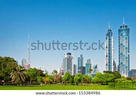 DUBAI, UAE - JUNE 4: View of skyscrapers of the city park on June 4, 2013 in Dubai. View of the Burj Khalifa - the tallest building in the world - stock photo