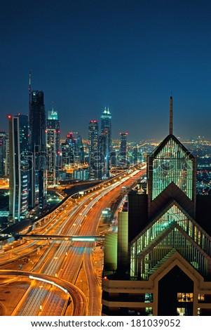 DUBAI, UAE - MAR 2: Busy Sheikh Zayed Road  in the evening March 2,2014 in Dubai, UAE - stock photo