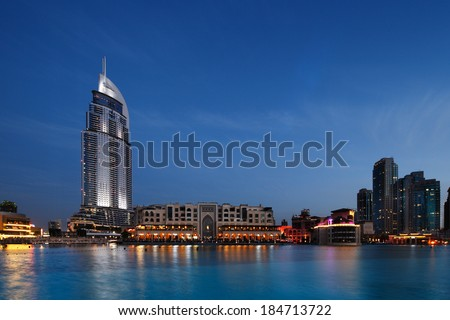 DUBAI, UAE - MAR 24: The Dubai Mall and The Address Hotel at Dusk on Mar 24, 2014 in Dubai, UAE. The Dubai Mall is the largest shopping mall in the world with some 1200 stores  - stock photo