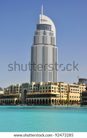DUBAI, UAE - MARCH 23: Address Hotel and Lake Burj Dubai on March 23, 2011 in Dubai. The hotel is 63 stories high and feature 196 lavish rooms and 626 serviced residences . - stock photo
