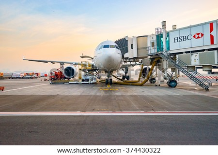 DUBAI, UAE - MARCH 30, 2015: Airbus A330-200 at Dubai International Airport. The Airbus A330 is a medium to long range wide-body twin-engine jet airliner made by Airbus. - stock photo