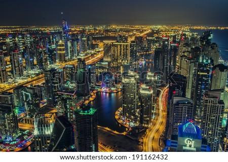 DUBAI, UAE - MARCH 21: Beautiful aerial view of Dubai Marina just after the sunset in Dubai March 21, 2014 - stock photo