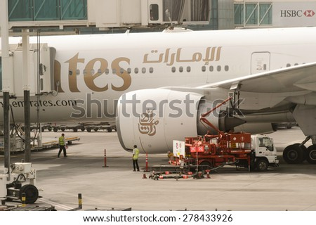 DUBAI, UAE - MARCH 10, 2015: Dubai International Airport. It is an international airport serving Dubai and a major airline hub in the Middle East, and is the main airport of Dubai. - stock photo