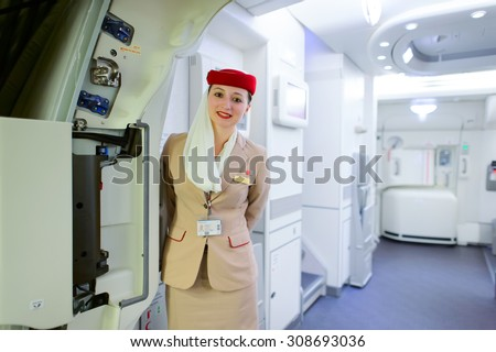 DUBAI, UAE - MARCH 10, 2015: Emirates Airbus A380 crew member. Emirates handles major part of passenger traffic and aircraft movements at the airport. - stock photo