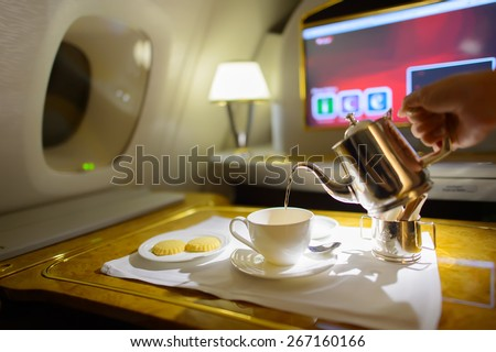 DUBAI, UAE - MARCH 31, 2015: Emirates first class interior. Emirates is one of two flag carriers of the United Arab Emirates along with Etihad Airways and is based in Dubai. - stock photo