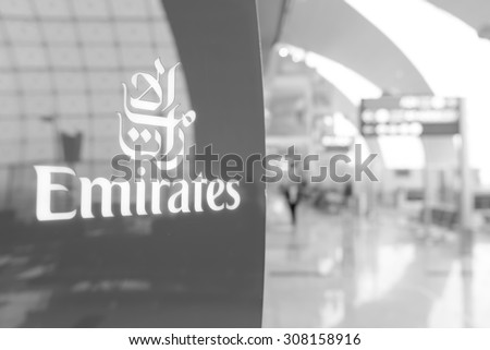 DUBAI, UAE - MARCH 31: Emirates logo on red background. Dubai International Airport is an international airport serving Dubai. It is a major airline hub in the Middle East - stock photo