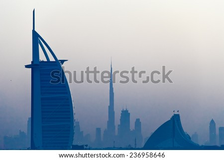DUBAI, UAE - MARCH 3: View of the luxury hotel Burj Al Arab, Burj Khalifa and Jumeirah Beach Hotel at sunrise, on March 3, 2013  in Dubai, United Arab Emirates.  - stock photo