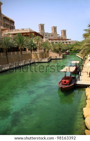 DUBAI, UAE - MAY 25: Artificial Channel  in Madinat Jumeirah hotel on May 25, 2011 in Dubai. Madinat Jumeirah is a luxury 5 star hotel with its own artificial canals and boats.