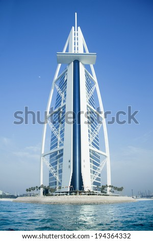 DUBAI, UAE -  MAY 10: Burj Al Arab hotel on May  10, 2014 in Dubai.  Architect Tom Wright. Most iconic building in UAE.  Back side of hotel, view from sea. - stock photo