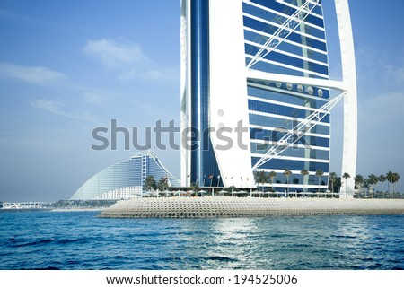 DUBAI, UAE -  MAY 10: Burj Al Arab hotel on May  10, 2014 in Dubai.  Architect Tom Wright. Most iconic building in UAE, view from gulf  - stock photo