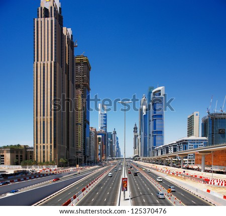 DUBAI, UAE - MAY 7 - E11 highway is the longest road in the UAE. It crosses Dubai where it is called the Sheikh Zayed Road. Graced with skyscrapers on both sides. Picture taken on May 7, 2010. - stock photo