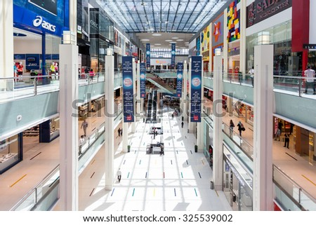 DUBAI, UAE - May 15: Shoppers at Dubai Mall on May 15, 2014 in Dubai. At over 12 million sq ft, it is the world's largest shopping mall based on total area and 6th largest by gross leasable area.