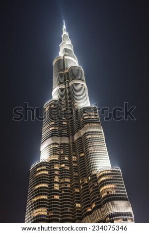 Dubai, UAE ;01.06.2013.Night lights of Burj Al Khalifa, the tallest building in Dubai and in the world , low angle view - stock photo