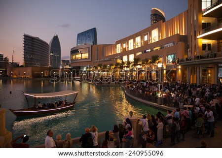 Dubai, UAE - Nov 23, 2013: Crowded park of Dubai Business Bay; people from around the world are spending time after sunset.