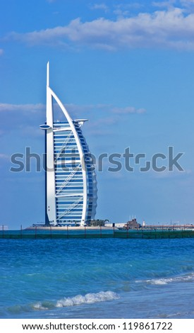 "DUBAI, UAE-NOVEMBER 15: A general view of the world's first seven stars luxury hotel Burj Al Arab ""Tower of the Arabs"" on November 15, 2012 in Dubai. Also known as ""Arab Sail"" - stock photo"