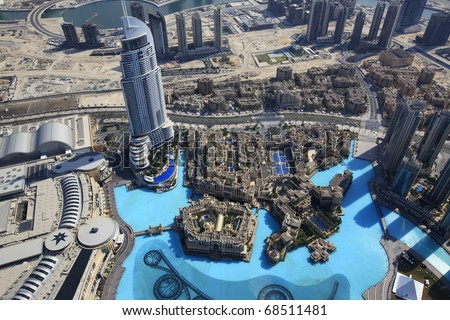 DUBAI, UAE - NOVEMBER 22: Address Hotels, Souk Al Bahar, Palace The Old Town and Lake Burj Dubai on November 22, 2010 in Dubai, UAE. View Downtown Dubai from the height of the Burj Khalifa. - stock photo