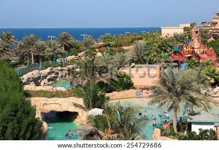 DUBAI, UAE - NOVEMBER 3: Aquaventure waterpark of Atlantis the Palm hotel, located on man-made island Palm Jumeirah on November 3, 2013 in Dubai, UAE - stock photo