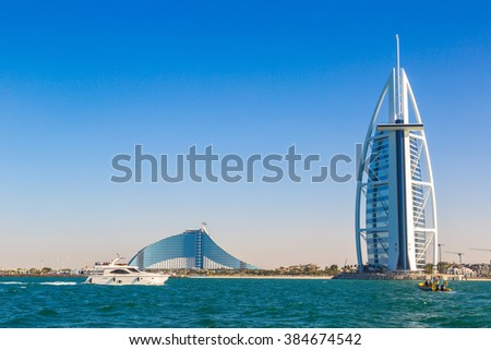 DUBAI, UAE - NOVEMBER 14: Burj Al Arab hotel and Jumeirah Beach Hotel in Dubai, United Arab Emirates, November 14, 2015 - stock photo