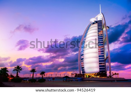 DUBAI, UAE - NOVEMBER 27: Burj Al Arab hotel on Nov 27, 2011 in Dubai. Burj Al Arab is a luxury 5 stars hotel built on an artificial island in front of Jumeirah beach. - stock photo