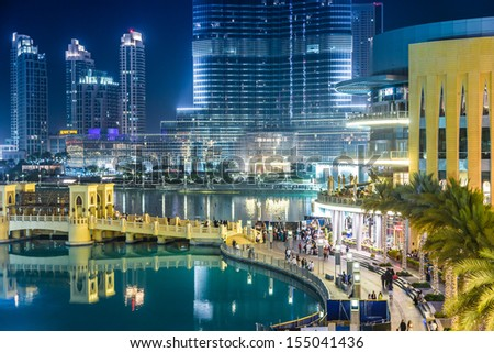 DUBAI, UAE - NOVEMBER 13: Burj Khalifa and Dubai Mall on November 13, 2012 in Dubai, UAE. Burj Khalifa is currently the tallest building in the world, at 829.84 m (2,723 ft). - stock photo