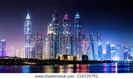 DUBAI, UAE - NOVEMBER 13: Dubai downtown night scene with city lights, luxury new high tech town in middle East, United Arab Emirates architecture. Dubai Marina cityscape, UAE - stock photo