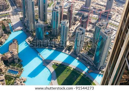 DUBAI, UAE. - NOVEMBER 29 : Dubai,the top view on Dubai from the tallest building in the world, Burj Khalifa, at 828m. on November 29, 2011 in Dubai, UAE. Day View - stock photo