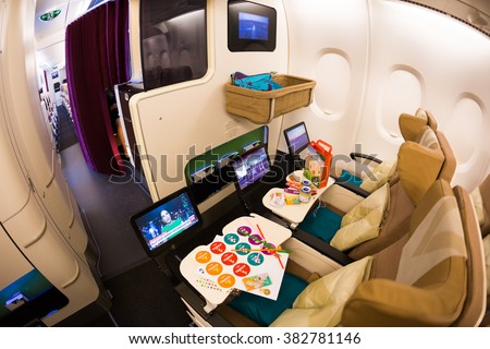 Dubai, UAE - NOVEMBER 09, 2015: Etihad Airways Airbus A380 airplane baby travel. Children bassinet. Children travel. Airplane seats for passengers with children on November 09, 2015 in Dubai - stock photo