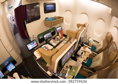 Dubai, UAE - NOVEMBER 09, 2015: Etihad Airways Airbus A380 family travel seats. Family travel airplane seats. Airline children meals, toys. Travel with children on November 09, 2015 in Dubai - stock photo
