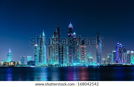 DUBAI, UAE - NOVEMBER 7: General view of the Dubai Marina at night, on November 7, 2013, Dubai, UAE. In the city of artificial channel length of 3 kilometers along the Persian Gulf. - stock photo