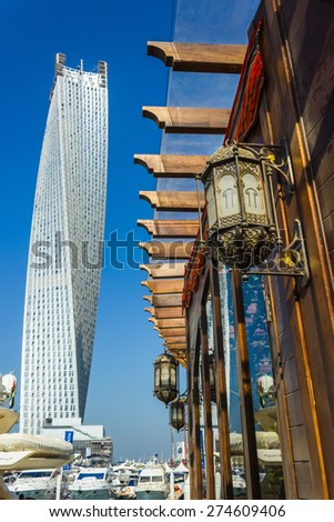 DUBAI, UAE - NOVEMBER 13: High rise buildings and streets nov 13. 2012  in Dubai, UAE. Dubai was the fastest developing city in the world between 2002 and 2008. - stock photo