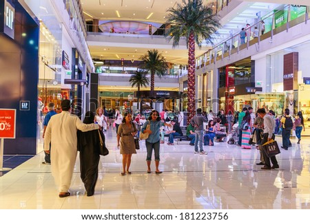 DUBAI, UAE - NOVEMBER 9: Inside modern luxuty mall on November 9, 2013 in Dubai. At over 12 million sq ft, it is the world's largest shopping mall based on total area. - stock photo