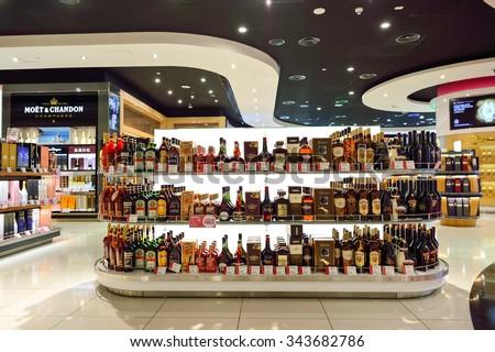 DUBAI, UAE - NOVEMBER 21, 2015: interior of Dubai Duty Free. Dubai Duty Free is the largest single airport retail operation in the world - stock photo