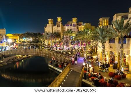 DUBAI, UAE - NOVEMBER 23: Madinat Jumeirah luxury hotel at night in Dubai, UAE on 23 November 2015 - stock photo