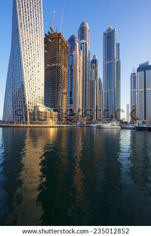 DUBAI, UAE - NOVEMBER 27: Modern buildings in Dubai Marina, Dubai, UAE. In the city of artificial channel length of 3 kilometers along the Persian Gulf, taken on 27 November 2014 in Dubai.  - stock photo