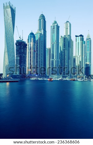 DUBAI, UAE - NOVEMBER 27: Modern buildings in Dubai Marina, Dubai, UAE. In the city of artificial channel length of 3 kilometers, taken on 27 November 2014 in Dubai.  - stock photo